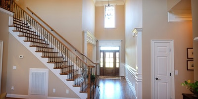 Light gray, white trim, vaulted ceilings, staircase, view of front door - Residential painting