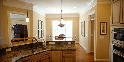 Light gray, taupe eat in kitchen with tall windows and hardwood floors - Residential painting