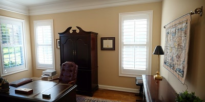 Light tan, taupe home office area with white trim and hardwood floors - Residential painting