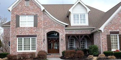 Exterior white trim and stained wood trim on a brick house - Residential painting