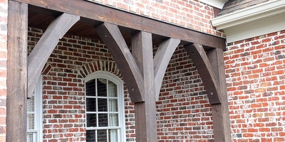 Exterior wood trim staining, front porch area on a brick home - Residential painting
