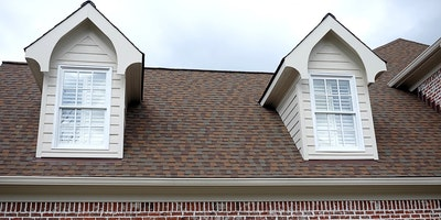 Exterior trim paint on outdoor windows from second floor on a brick home - Residential painting