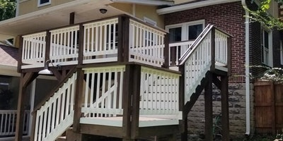 Exterior brown and white paint on porch and stairway - Residential painting
