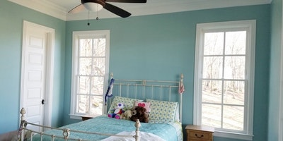 Blue bedroom with matching bed - Residential painting by Nash Painting Nashville TN