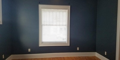 Dark blue room with wood floor - Residential painting by Nash Painting Nashville TN