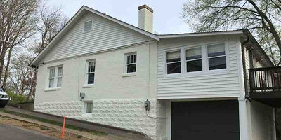 White Exterior Paint with a Teal Front Door - Residential painting by Nash Painting Nashville TN