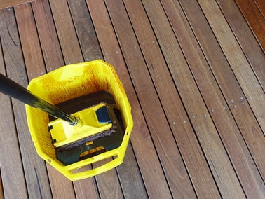 Deck being stained in Tennessee